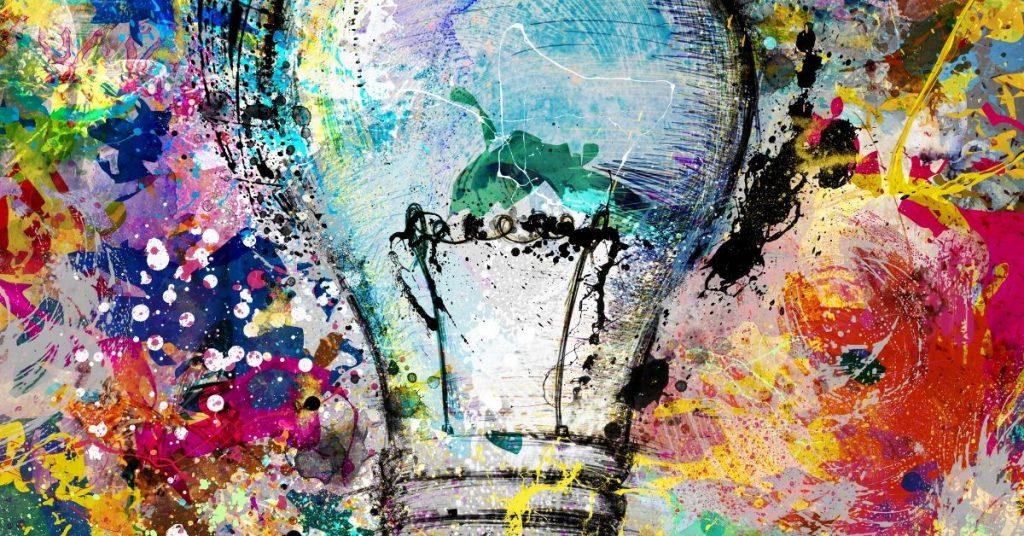 Een afbeelding van een gekleurd kunstwerk met hierop een gloeilamp